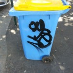 Graffiti needs to be removed from this bin.